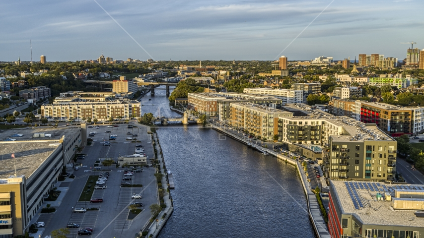 Apartment complexes by the Milwaukee River at sunset, Milwaukee, Wisconsin Aerial Stock Photos | DXP002_150_0002