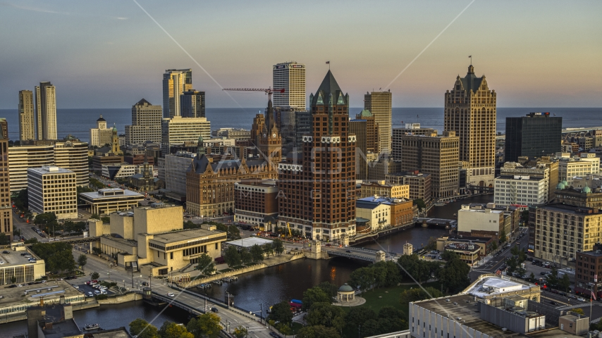 A riverfront office tower at twilight, Downtown Milwaukee, Wisconsin Aerial Stock Photos | DXP002_150_0005
