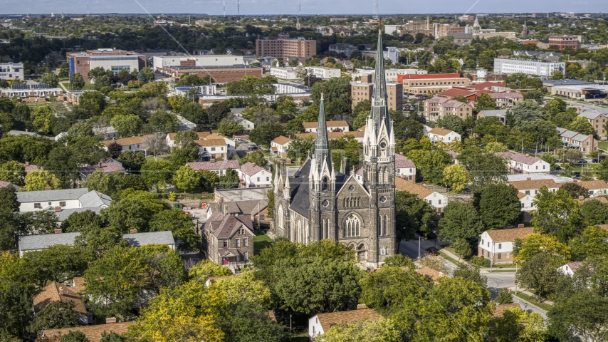 A church in a residential neighborhood in Milwaukee, Wisconsin Aerial Stock Photo DXP002_152_0006 | Axiom Images
