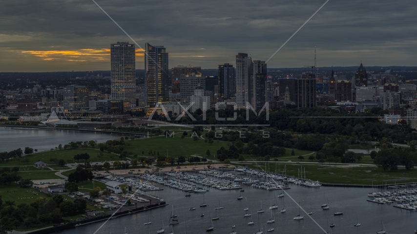 The marina and a view of the city's skyline at night, Downtown Milwaukee, Wisconsin Aerial Stock Photos | DXP002_155_0004