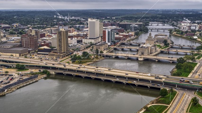 Bridges spanning the river by Downtown Cedar Rapids, Iowa Aerial Stock Photos | DXP002_164_0005