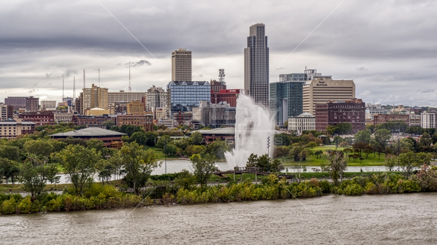 A fountain and riverfront park with view of skyline, Downtown Omaha, Nebraska Aerial Stock Photos | DXP002_169_0006