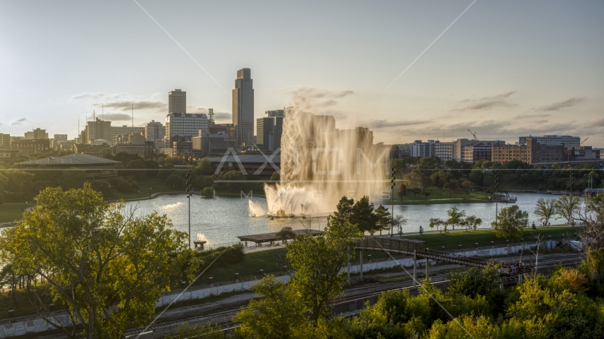 A view of a fountain with view of skyline at sunset, Downtown Omaha, Nebraska Aerial Stock Photos | DXP002_172_0004