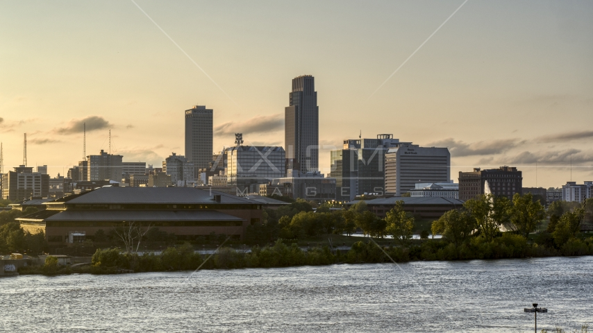 The skyline at sunset, seen from the river, Downtown Omaha, Nebraska Aerial Stock Photos | DXP002_172_0006