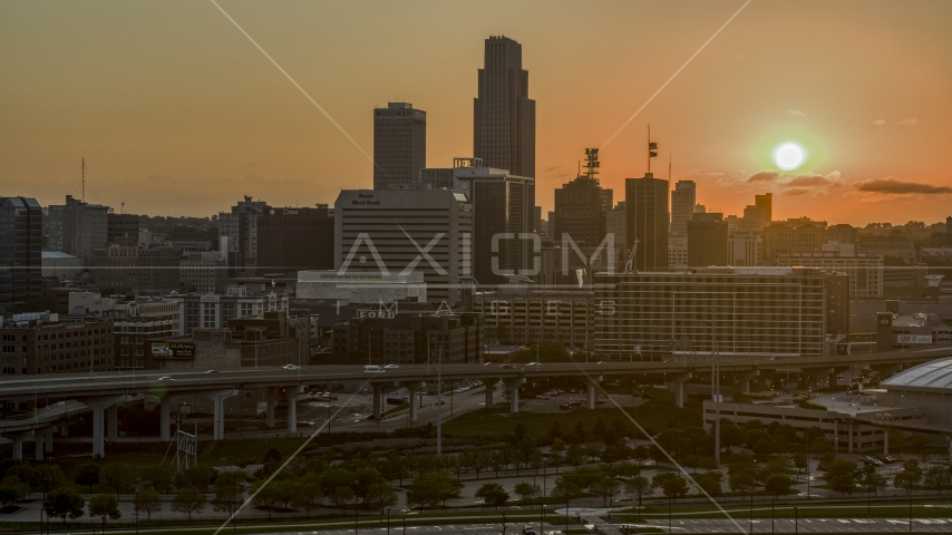 A skyscraper and skyline with view of setting sun, Downtown Omaha, Nebraska Aerial Stock Photos | DXP002_172_0010