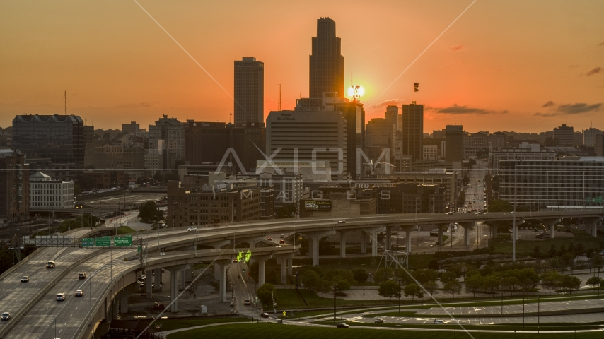 The skyline with the setting sun in background, Downtown Omaha, Nebraska Aerial Stock Photos | DXP002_172_0011