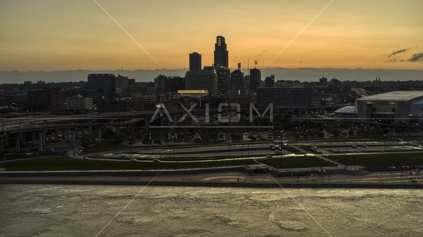 The skyline at sunset, seen from the Missouri River, Downtown Omaha, Nebraska Aerial Stock Photos | DXP002_172_0013