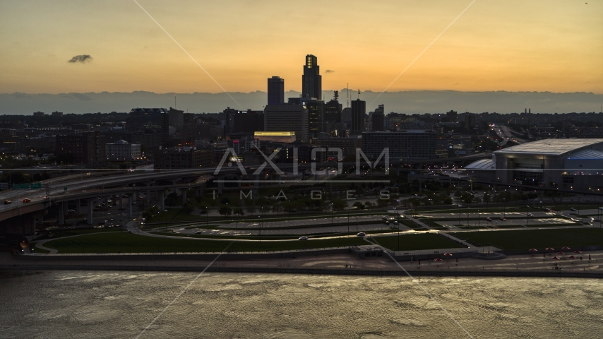 A view of the skyline from the river at twilight, Downtown Omaha, Nebraska Aerial Stock Photo DXP002_172_0015 | Axiom Images
