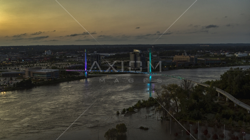 A pedestrian bridge spanning the Missouri River at twilight, Omaha, Nebraska Aerial Stock Photos | DXP002_172_0016
