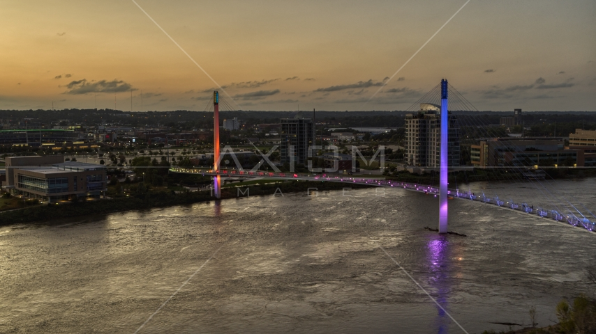 A colorful pedestrian bridge spanning the Missouri River at twilight, Omaha, Nebraska Aerial Stock Photo DXP002_172_0017 | Axiom Images