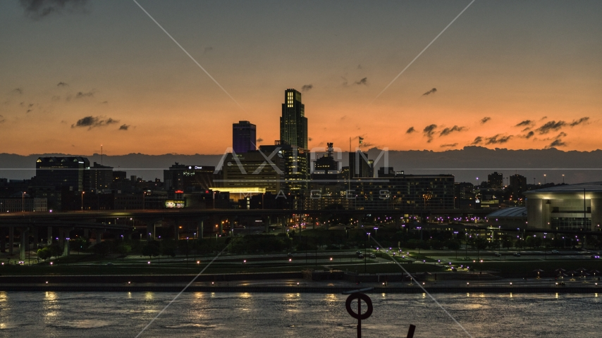 A view across the river toward the skyline at twilight, Downtown Omaha, Nebraska Aerial Stock Photos | DXP002_173_0002