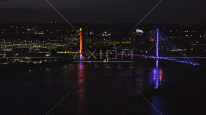 A pedestrian bridge spanning the Missouri River at night, Omaha, Nebraska Aerial Stock Photo DXP002_173_0005 | Axiom Images