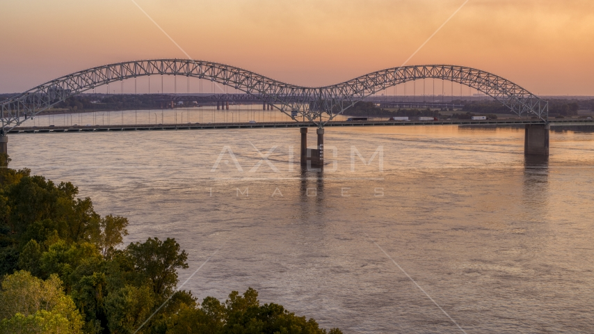 Traffic crossing the Hernando de Soto Bridge at sunset, Downtown Memphis, Tennessee Aerial Stock Photo DXP002_181_0001 | Axiom Images