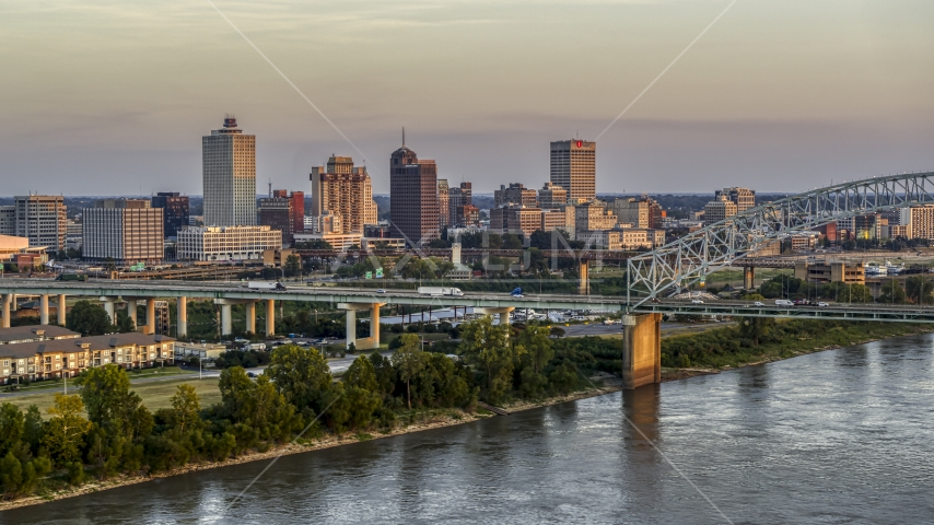 The city's skyline behind the bridge at sunset, Downtown Memphis, Tennessee Aerial Stock Photos | DXP002_181_0002