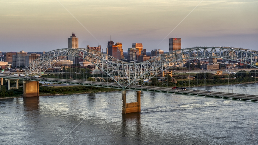 The city's skyline as traffic crosses the bridge at sunset, Downtown Memphis, Tennessee Aerial Stock Photo DXP002_181_0003 | Axiom Images