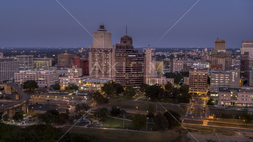 Office high-rises at twilight in Downtown Memphis, Tennessee Aerial Stock Photos | DXP002_182_0001