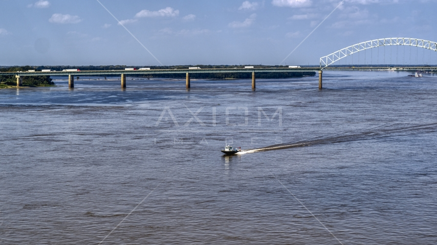A boat racing across the Mississippi River, Memphis, Tennessee Aerial Stock Photos | DXP002_183_0005