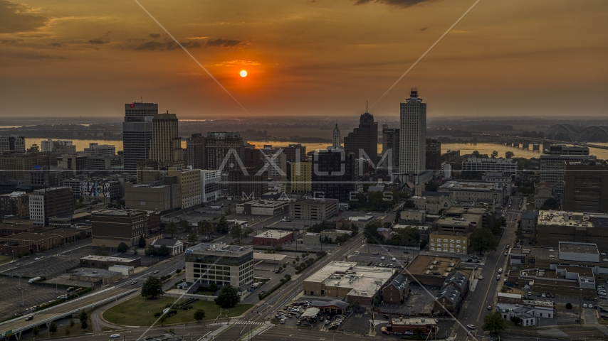 The city skyline and the setting sun, Downtown Memphis, Tennessee Aerial Stock Photos | DXP002_186_0002