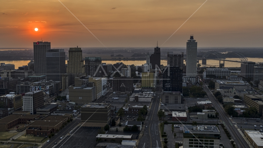 The downtown skyline and the setting sun, Downtown Memphis, Tennessee Aerial Stock Photos | DXP002_186_0003