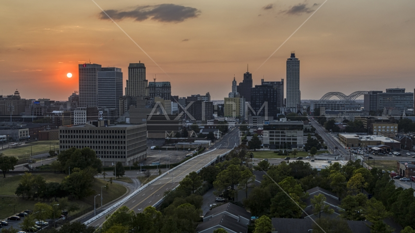A view of the downtown skyline and the setting sun, Downtown Memphis, Tennessee Aerial Stock Photos | DXP002_186_0004