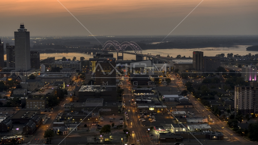 The Hernando de Soto Bridge, seen from Downtown Memphis, Tennessee at twilight Aerial Stock Photos | DXP002_187_0003
