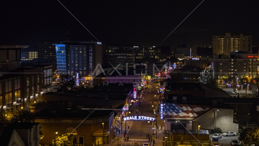 Busy Beale Street at nighttime, Downtown Memphis, Tennessee Aerial Stock Photo DXP002_188_0002 | Axiom Images