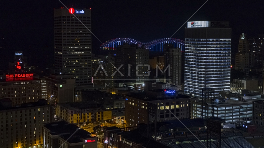 City buildings between office towers at nighttime, Downtown Memphis, Tennessee Aerial Stock Photos | DXP002_188_0003