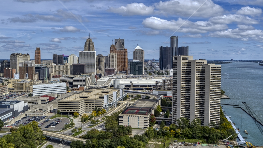 The skyline in the distance seen from apartment complex, Downtown Detroit, Michigan Aerial Stock Photos | DXP002_189_0002