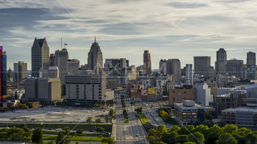The city skyline seen from Gratiot Avenue at sunset in Downtown Detroit, Michigan Aerial Stock Photos | DXP002_192_0001