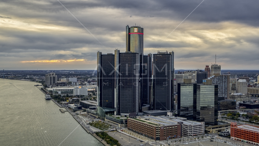 A riverfront skyscraper at sunset, Downtown Detroit, Michigan Aerial Stock Photos | DXP002_192_0007