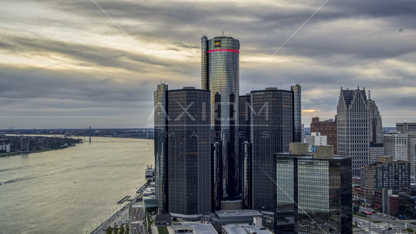 A towering riverfront skyscraper at sunset, Downtown Detroit, Michigan Aerial Stock Photos | DXP002_192_0008