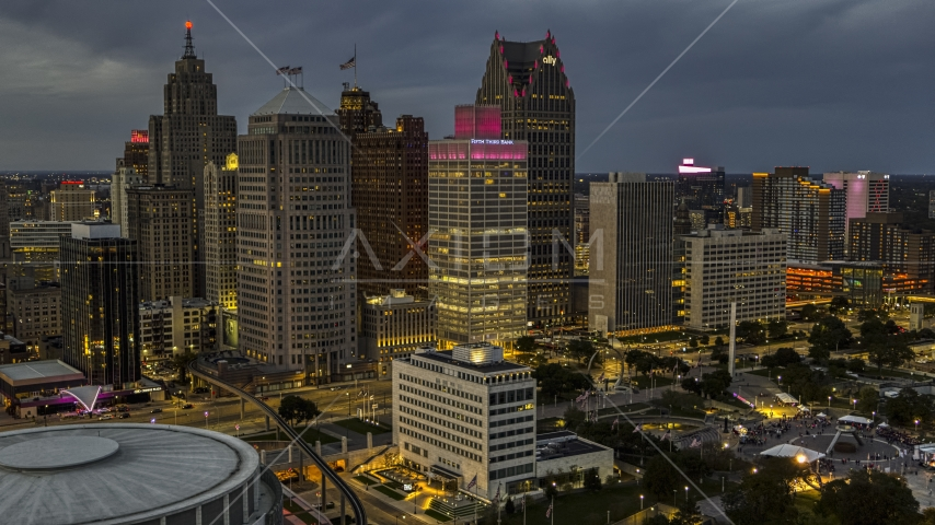 Tall skyscrapers at twilight in Downtown Detroit, Michigan Aerial Stock Photos | DXP002_193_0001