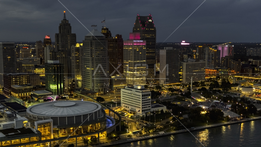The city's skyscrapers at twilight in Downtown Detroit, Michigan Aerial Stock Photos | DXP002_193_0004
