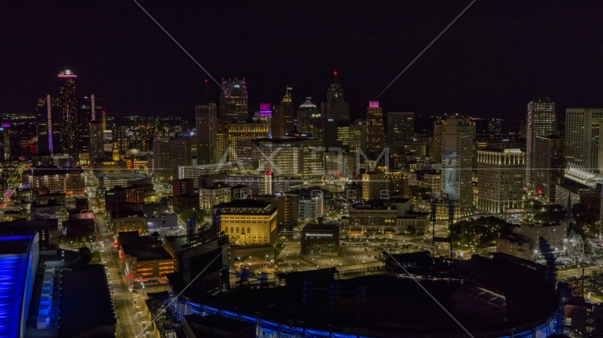 The city's skyline and baseball stadium at night, Downtown Detroit, Michigan Aerial Stock Photos | DXP002_193_0014