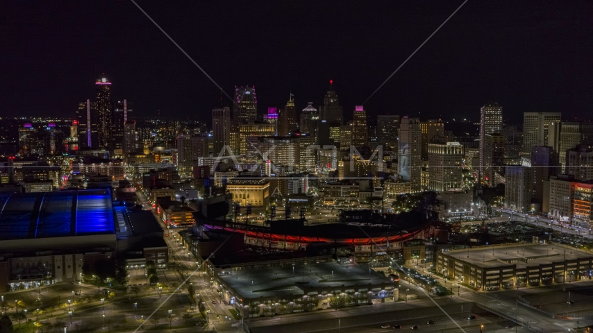 A wide view of the skyline and Comerica Park at night, Downtown Detroit, Michigan Aerial Stock Photos | DXP002_193_0015