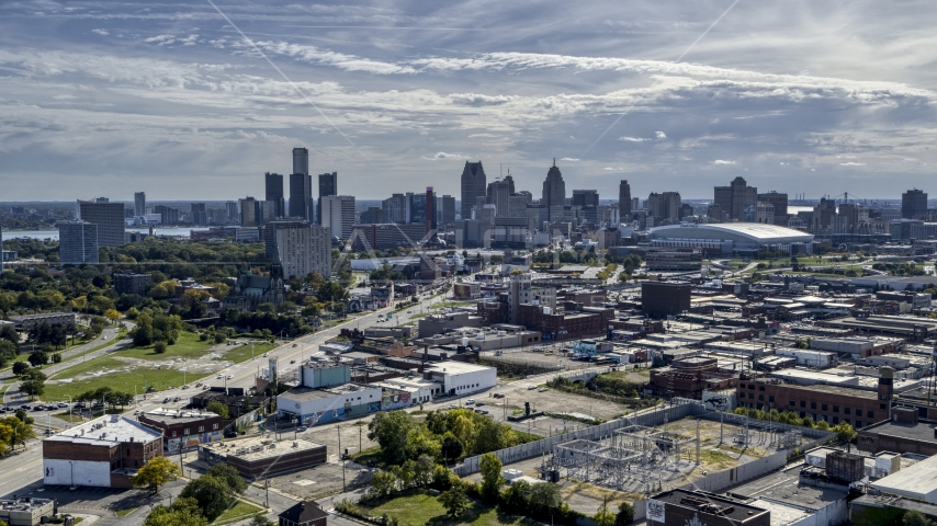 The city's skyline seen from brick industrial buildings, Downtown Detroit, Michigan Aerial Stock Photos | DXP002_195_0001