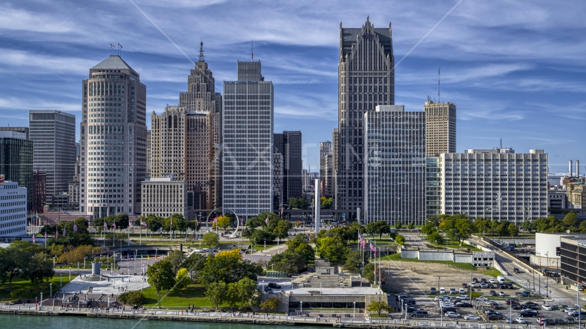 A view of towering skyscrapers across from Hart Plaza, Downtown Detroit, Michigan Aerial Stock Photos | DXP002_196_0002