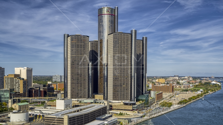 The GM Renaissance Center beside the river in Downtown Detroit, Michigan Aerial Stock Photos | DXP002_196_0006