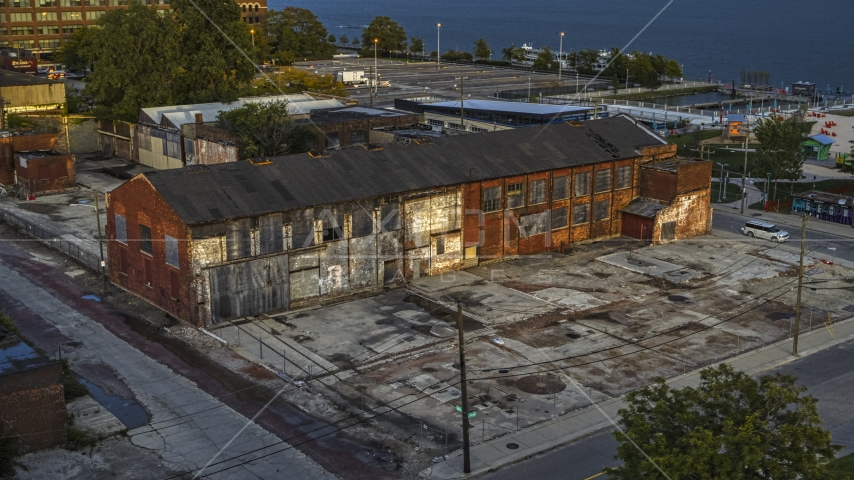 An abandoned Northern Cranes factory building at sunset, Detroit, Michigan Aerial Stock Photos | DXP002_197_0002