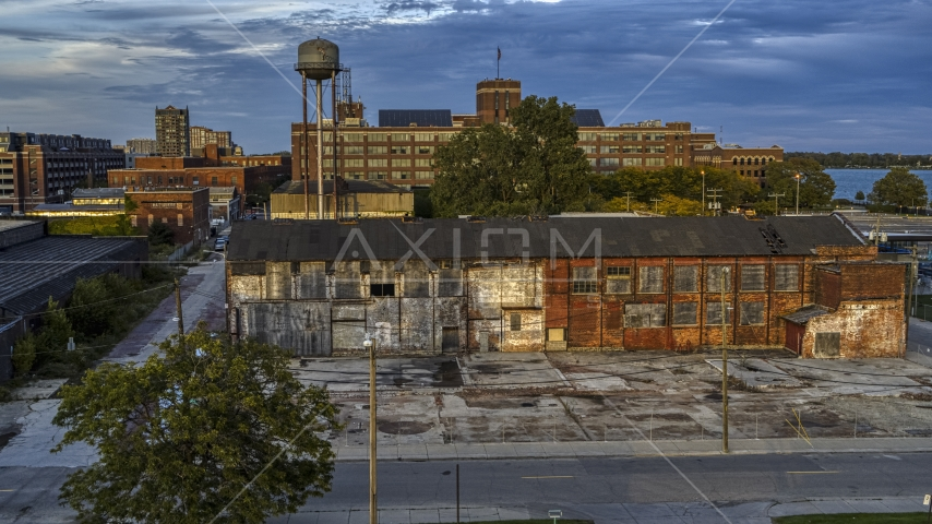 Abandoned factory building and water tower at sunset, Detroit, Michigan Aerial Stock Photos | DXP002_197_0003