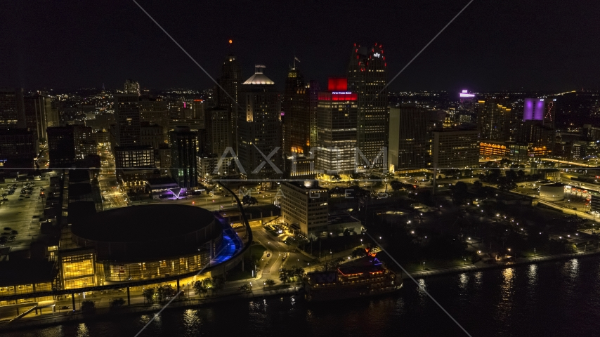 Towering skyscrapers and Hart Plaza at night, Downtown Detroit, Michigan Aerial Stock Photos | DXP002_199_0002