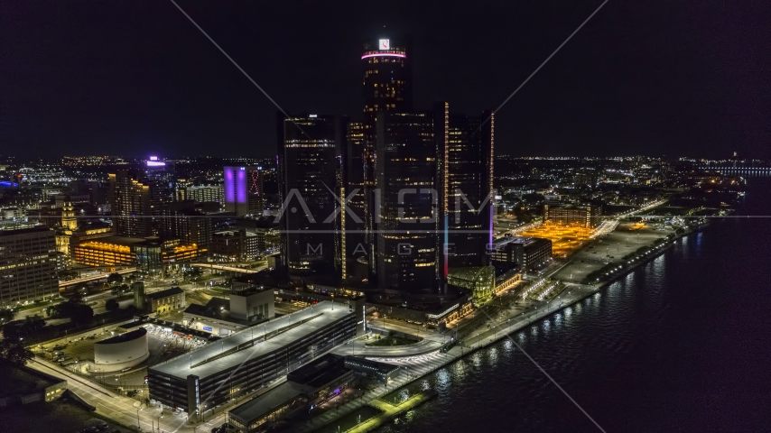 The GM Renaissance Center by the river at night, Downtown Detroit, Michigan Aerial Stock Photo DXP002_199_0004 | Axiom Images