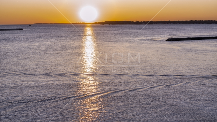 The setting sun over Lake Erie, Buffalo, New York Aerial Stock Photos | DXP002_204_0006