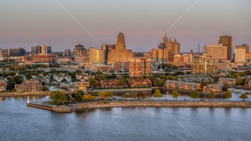 City hall and office buildings at sunset, seen from waterfront condos, Downtown Buffalo, New York Aerial Stock Photos | DXP002_204_0012