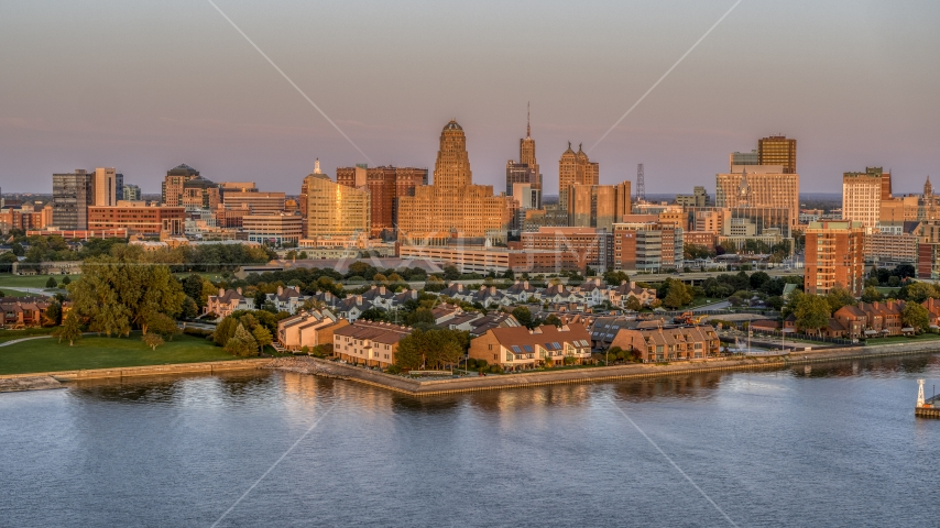 A view of city hall and office buildings at sunset, seen from waterfront condos, Downtown Buffalo, New York Aerial Stock Photos | DXP002_204_0013