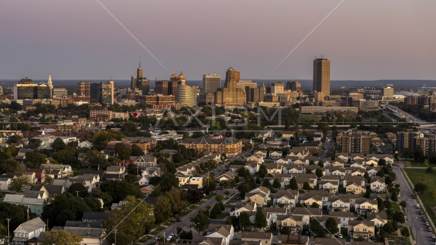 A wide view of the city's skyline at twilight, Downtown Buffalo, New York Aerial Stock Photos | DXP002_204_0015
