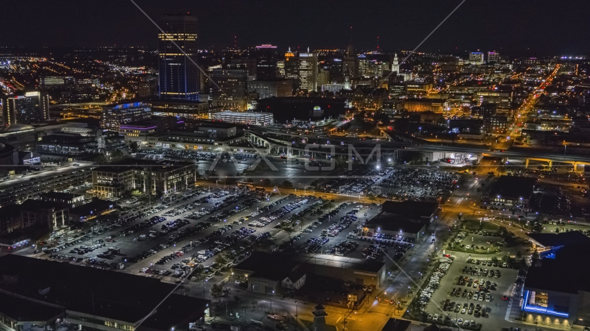 The skyline at night seen from arena parking lots, Downtown Buffalo, New York Aerial Stock Photo DXP002_205_0002 | Axiom Images