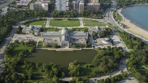 AX0001_009.0000165F - Aerial stock photo of The Museum of Science and Industry in Hyde Park, Chicago, Illinois