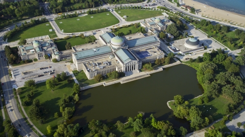 AX0001_009.0000328F - Aerial stock photo of A view of the Museum of Science and Industry, Hyde Park, Chicago, Illinois