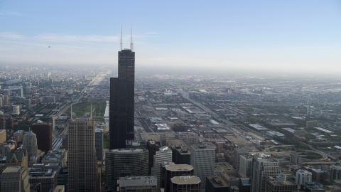 AX0001_034.0000351F - Aerial stock photo of Willis Tower and city sprawl, Downtown Chicago, Illinois